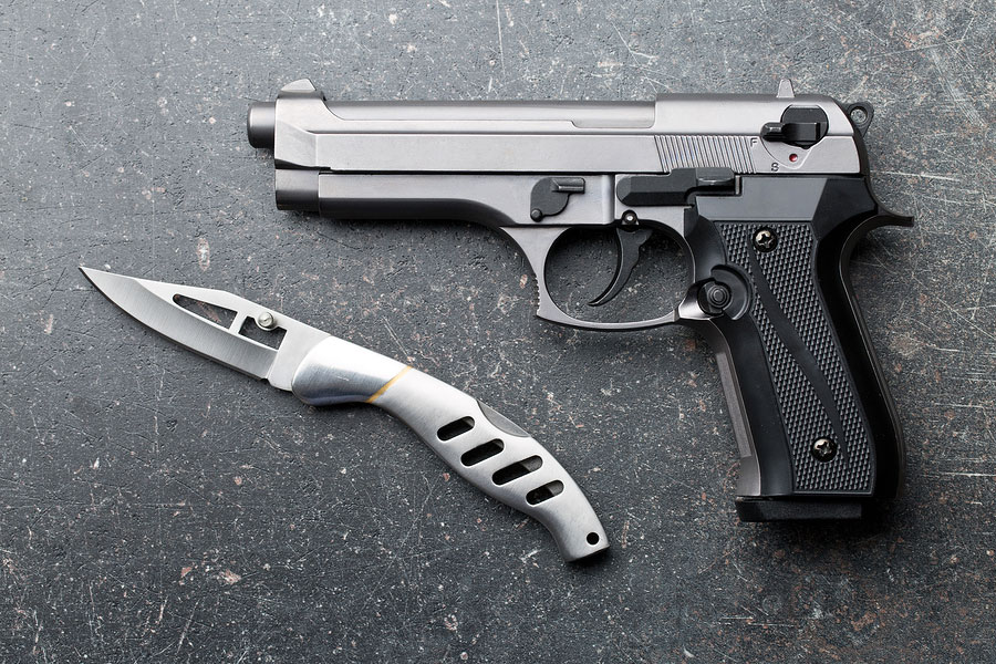 Handgun with pocket knife