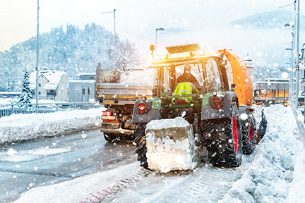 Snow plow plowing street