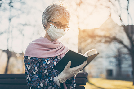 Senior Lady with Face Mask Reading the Bible