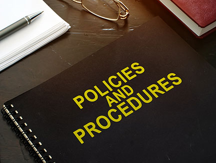 Policies and procedures company documents on a desk