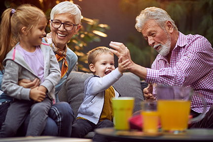 Cheerful grandchildren spending time with their grandparents